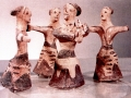 A CIRCLE OF WOMEN DANCING AROUND A WOMAN WITH A LYRE, Crete, c. 1500 b.c.e.